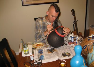 Ethan Brown painting the gourd
